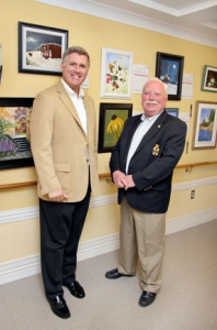 MLA representatives Cecil Clark and Keith Bain take a look at the paintings.