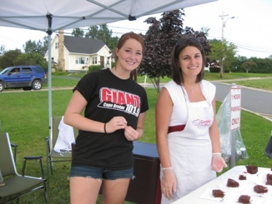 Erin McKenna of The Giant 101.9 was on deck helping fellow volunteer Amanda Keel serve yummy chocolate cake donated by Atlantic Superstore. August 13, 2010